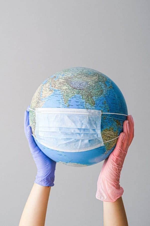 covid 19 test globe with mask